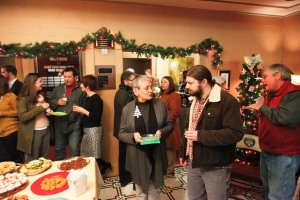 Annual Meeting and Holiday Party mingling